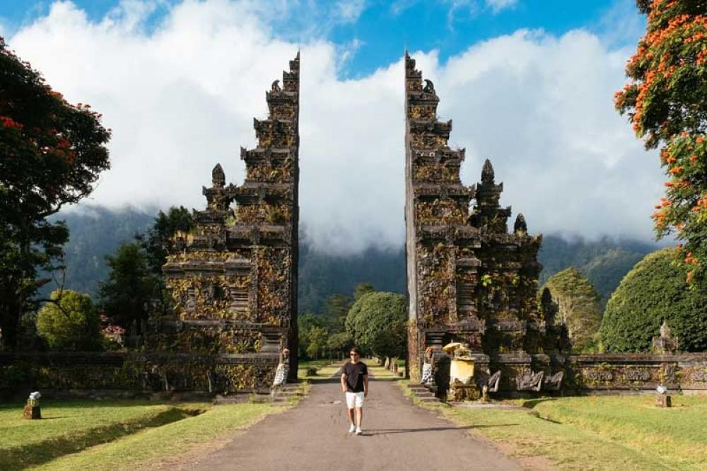 A Visitor Poses at Handara Gate