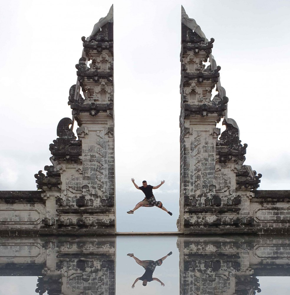 A Visitor Poses at Split Gate ofLempuyang Temple