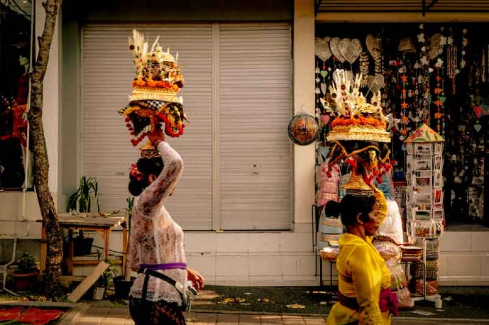 Balinese Woman Bring Traditional Offerings