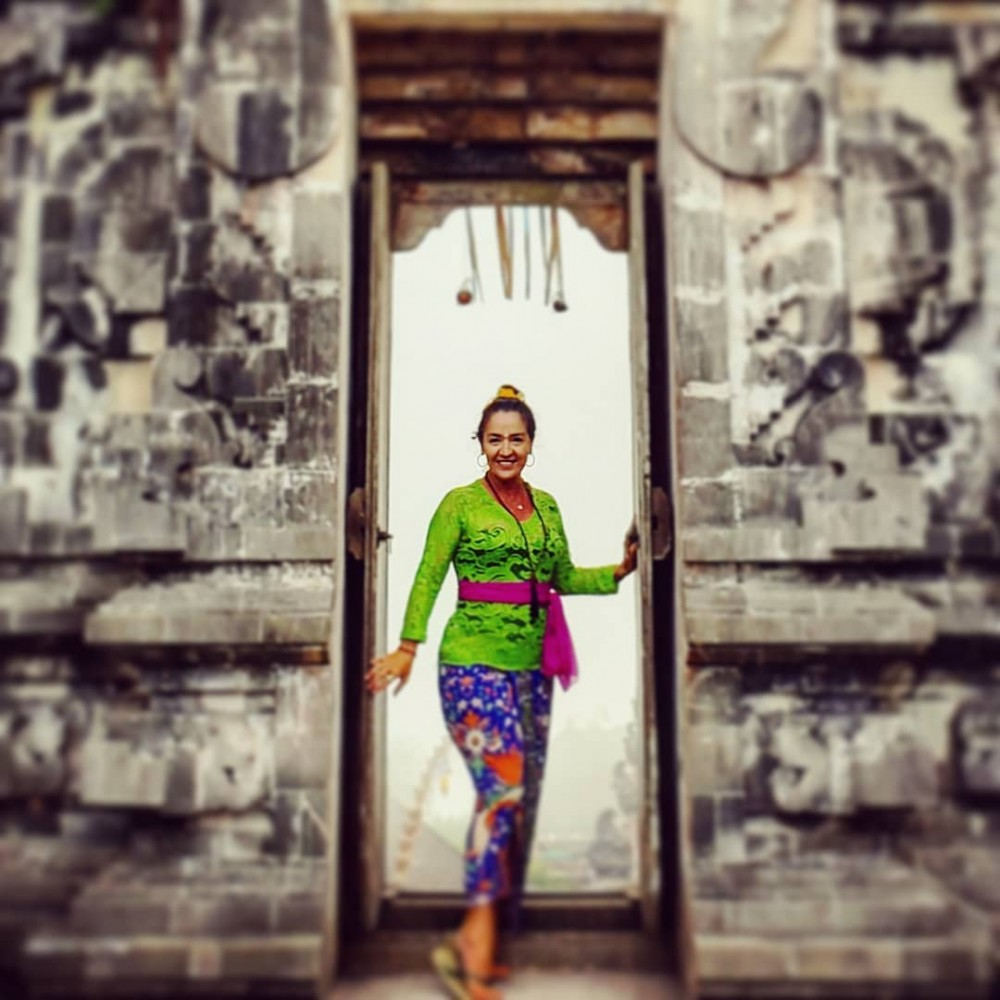 a woman with Balinese traditional clothes