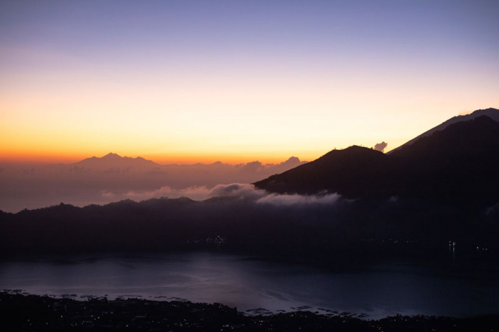 See Beautiful Sunrise with Sea of Clouds on Mount Batur