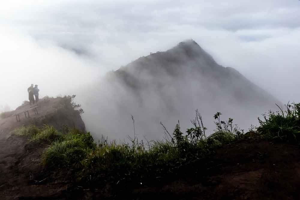 Two Hiker on the Peak of Mount Batur