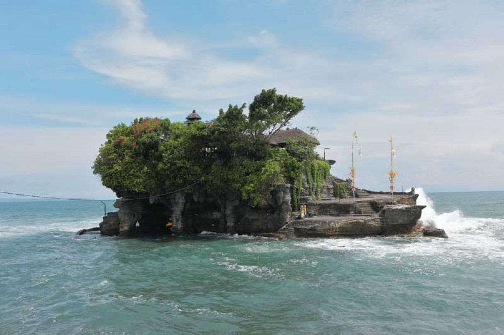Holy Snakes in Sacred Cave of Tanah Lot Temple