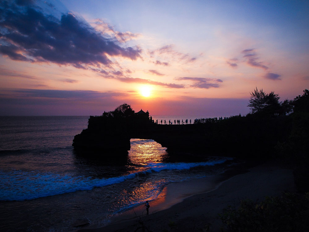 Perfect Sunset with Silhouette of Temple on Tanah Lot Sea