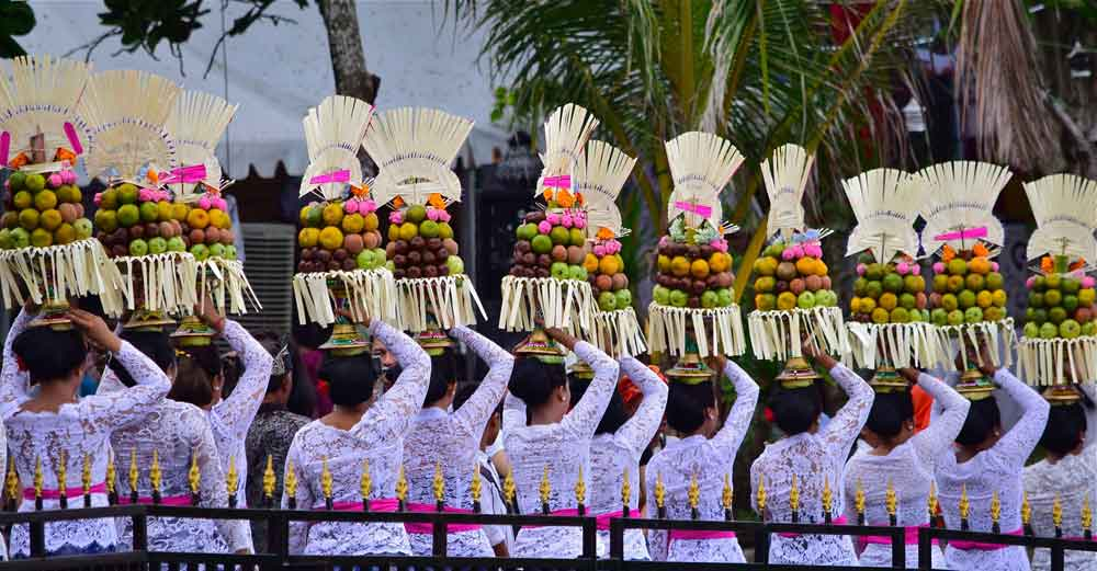 Balinese People are holding a ceremony at Tanah Lot Temple